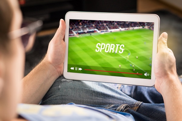 man watching sports on tablet